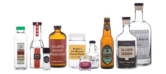 Assortment of bottles decorated with caps and sample labels